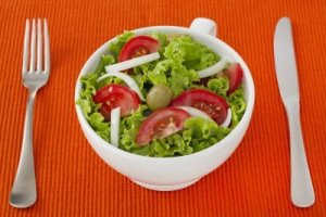15537734-vegetable-salad-in-white-bowl-with-fork-and-knife